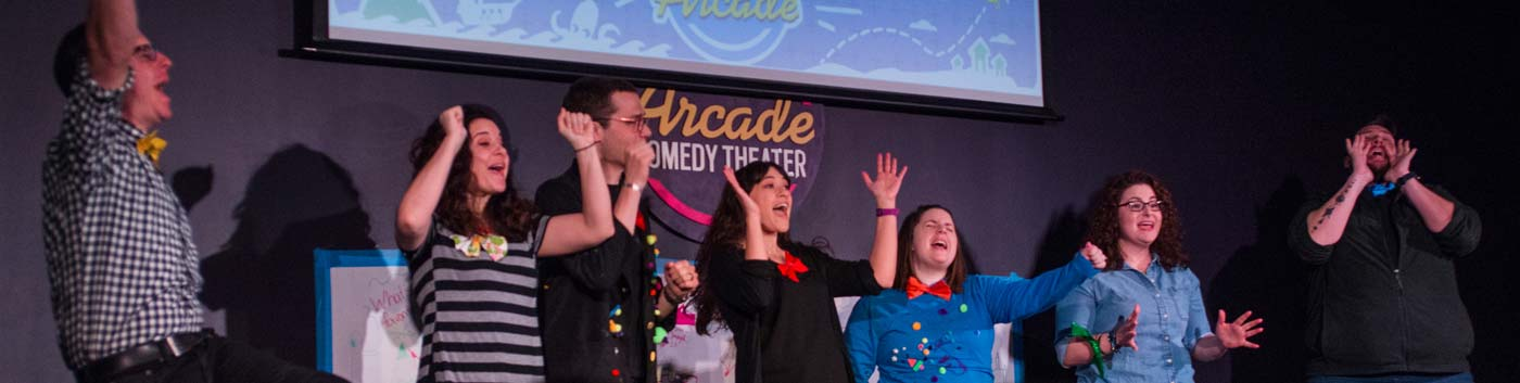 penny arcade cast on stage celebrating